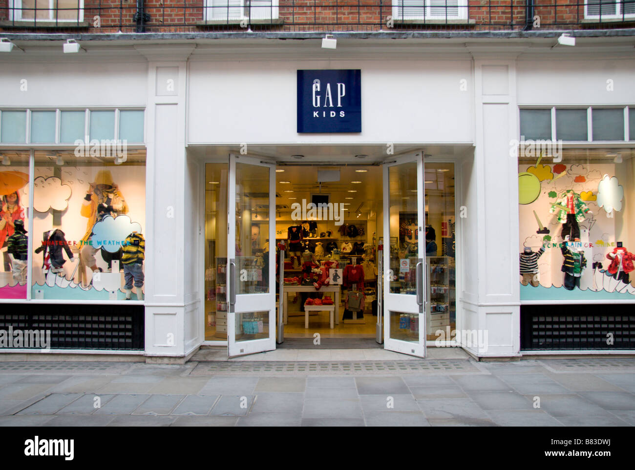 The shop entrance to the Baby Gap clothing shop in Covent ...