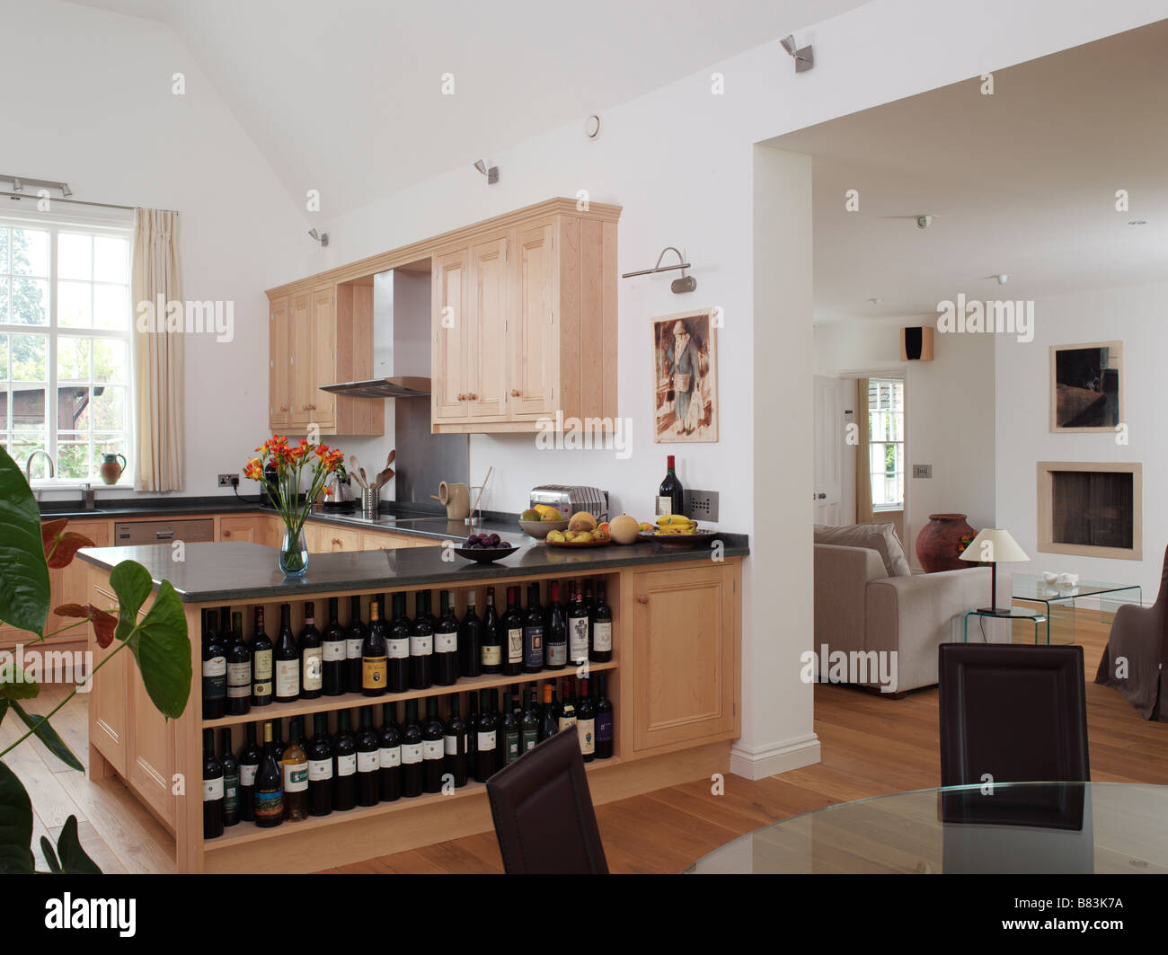 open plan kitchen and dining room with wine shelves and view