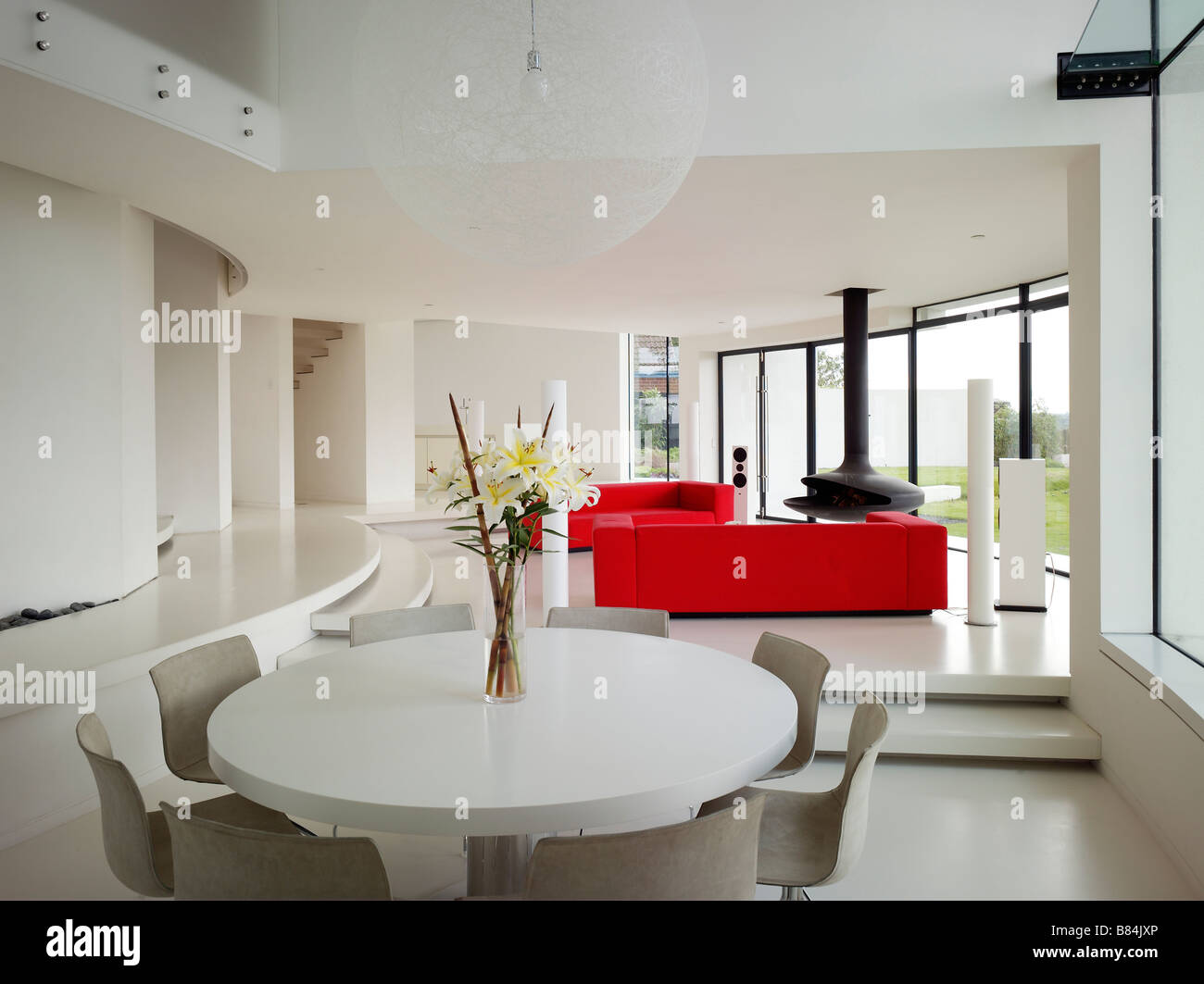 contemporary white open plan living and dining room with clam