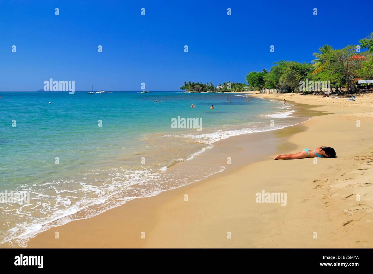 A woman is sun bathing at the beautiful rincn beach in rincn stock a woman is sun bathing at the beautiful rincn beach in rincn western puerto rico publicscrutiny Image collections