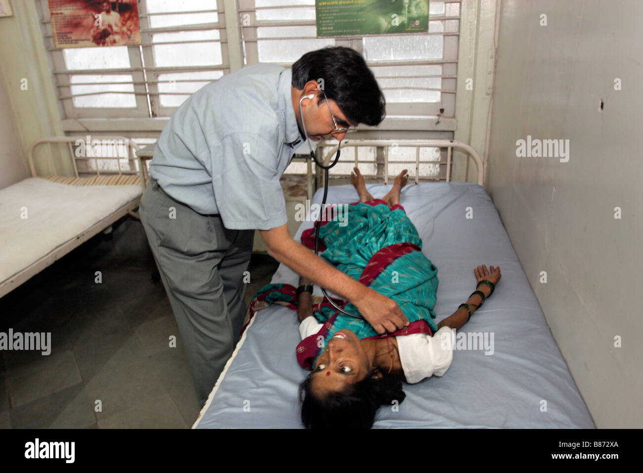 An Indian doctor looks after patients affected by hiv and ...