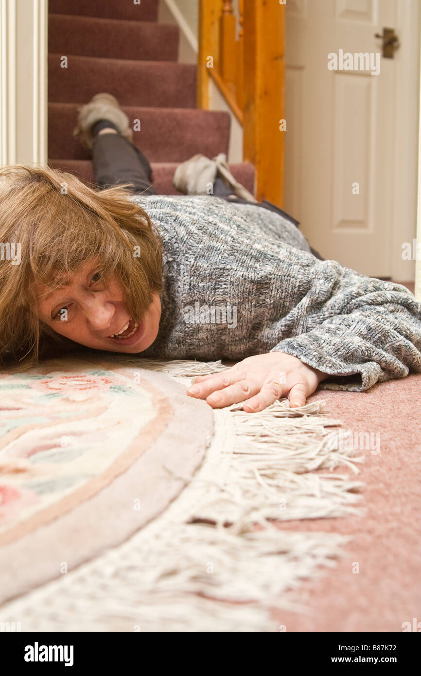 A Woman Lying On The Floor After Falling Down Stairs