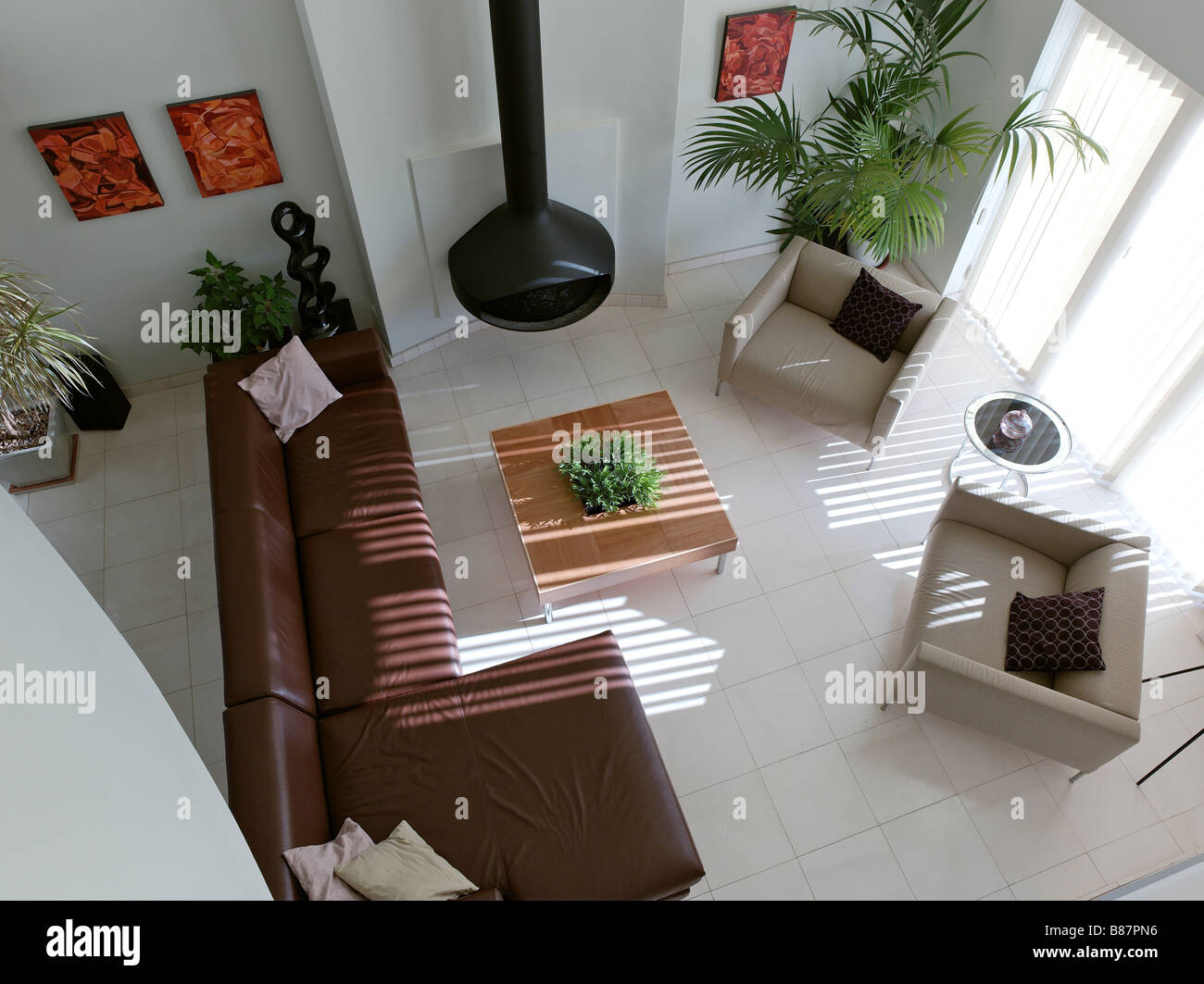 Corner sofa unique design living room sofa view modern new design - Stock Photo Birds Eye View Of Modern Living Room With Leather Corner Sofa And Contemporary Fireplace With Plants And Orange Paintings