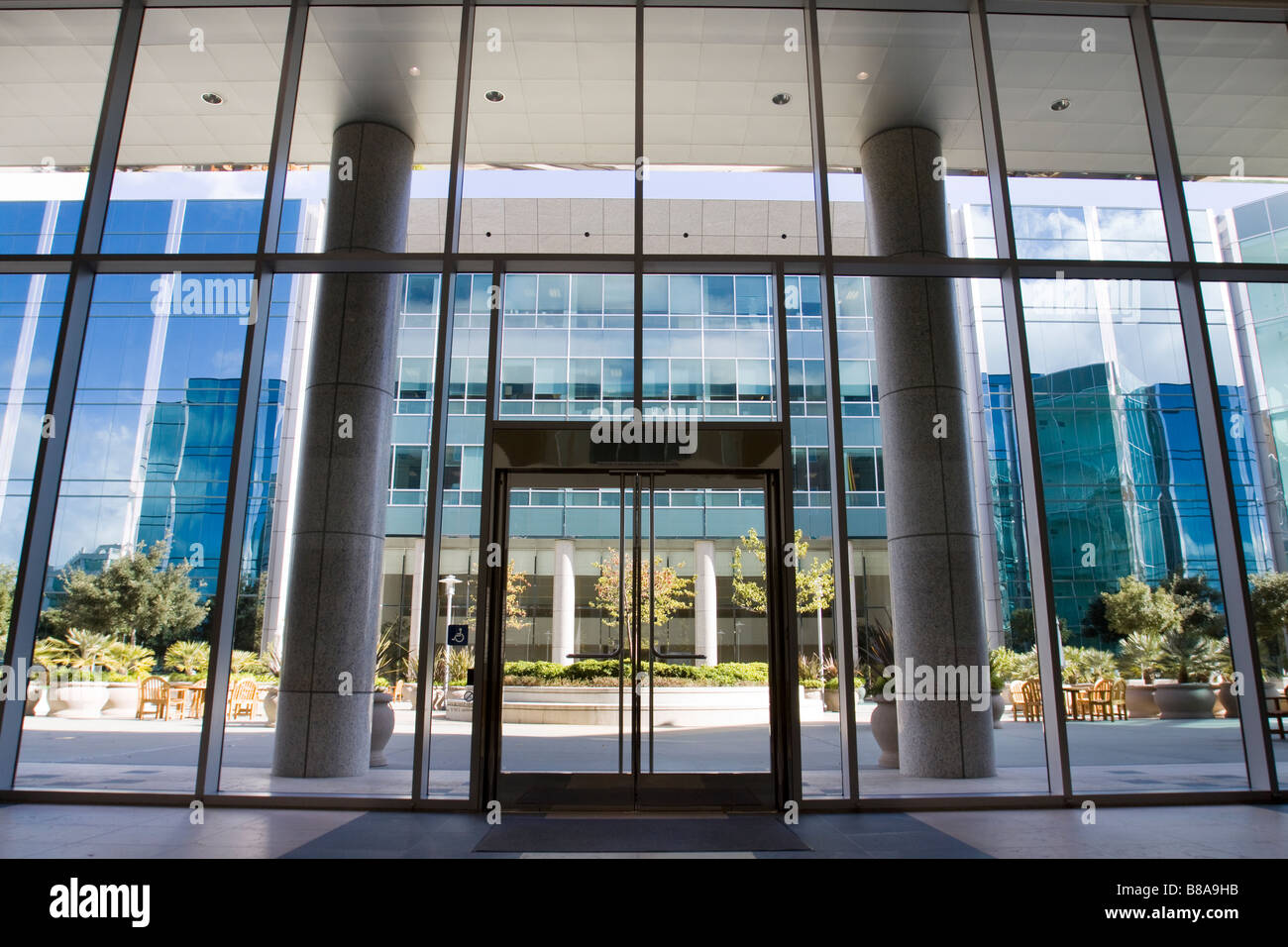 office front doors. Attractive Courtyard Patio Area As Seen Through The Glass Front Door Entrance To A Modern Office Building Complex Doors G