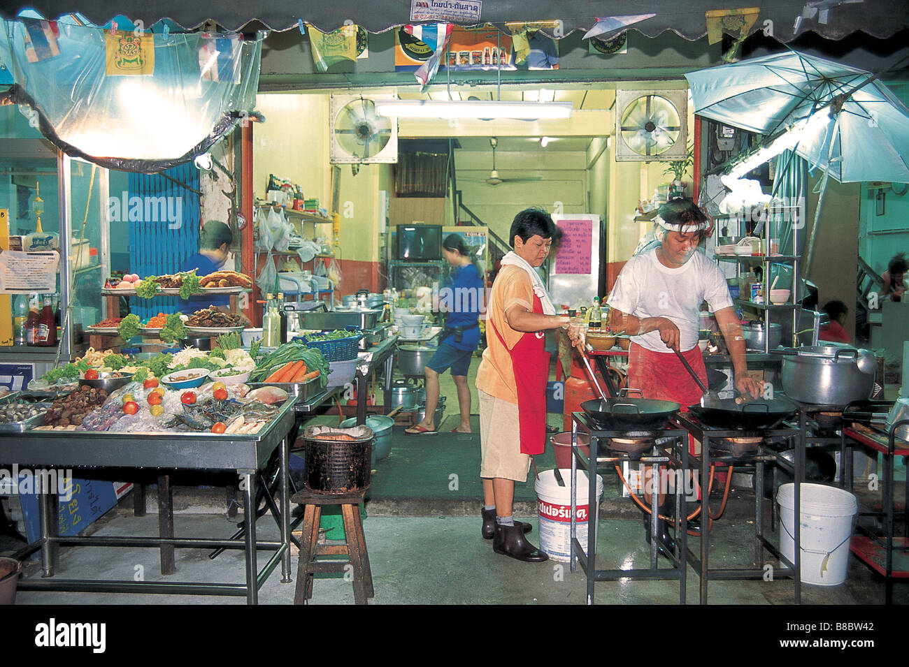 Busy Kitchen a busy kitchen run from a garage at an open air thai restaurant in