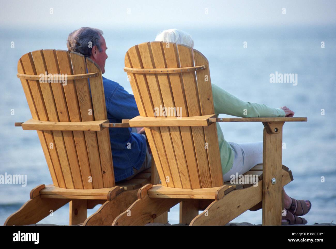 Adirondack chair beach - Senior Couple Sitting Adirondack Chairs Beach