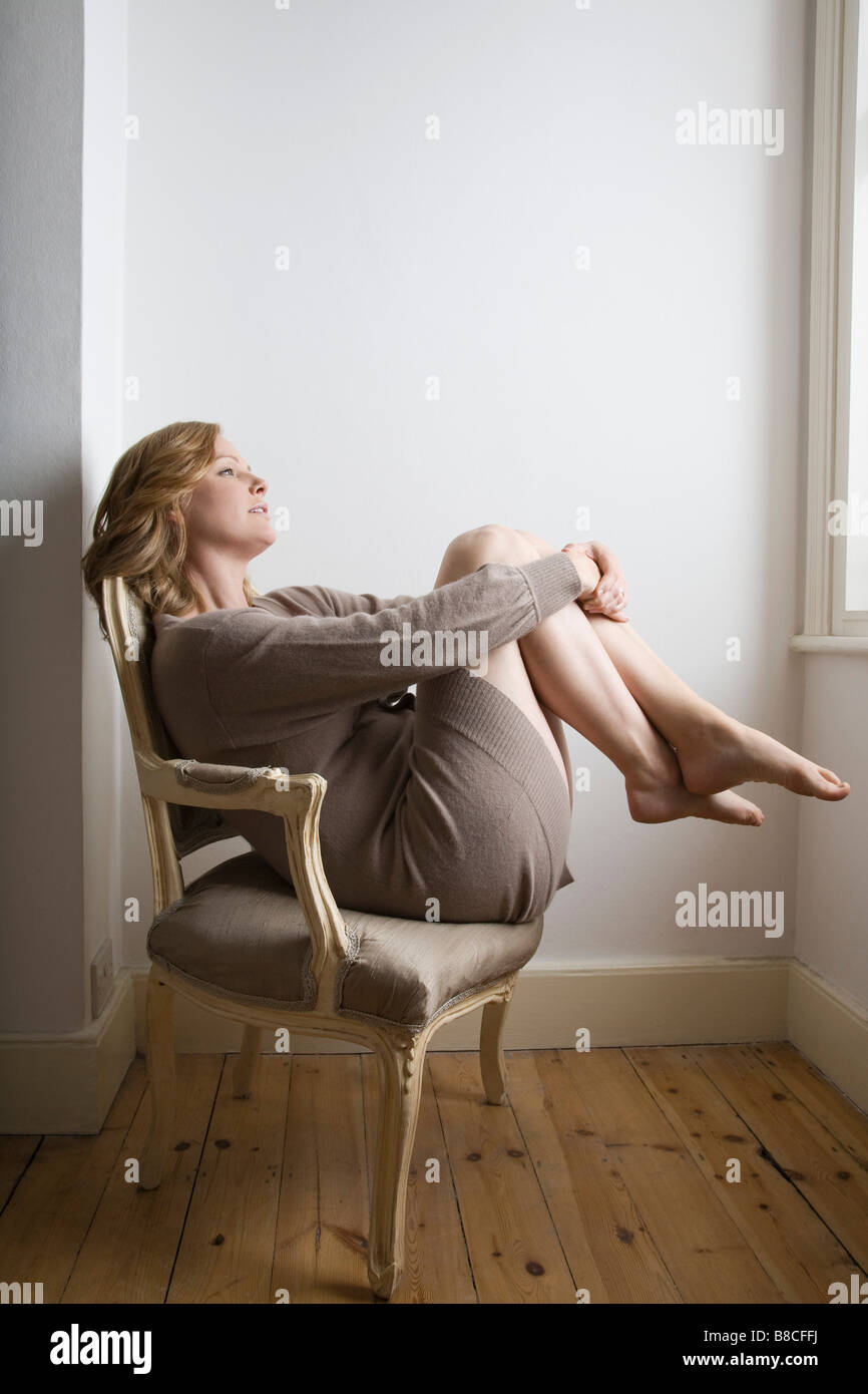 Old Fashioned Chair - Semi dress woman relaxing on old fashioned chair