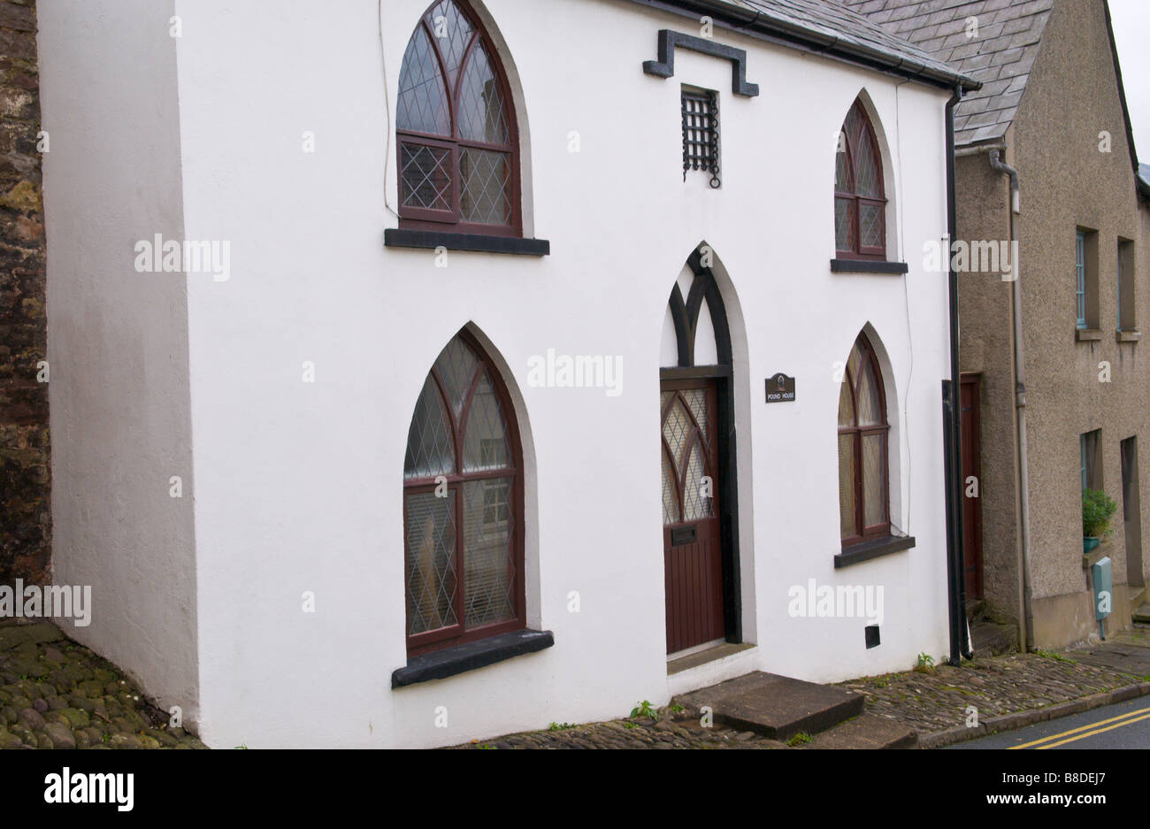 Small Detached House With Gothic Style Windows And Front Door In Crickhowell Powys Wales UK