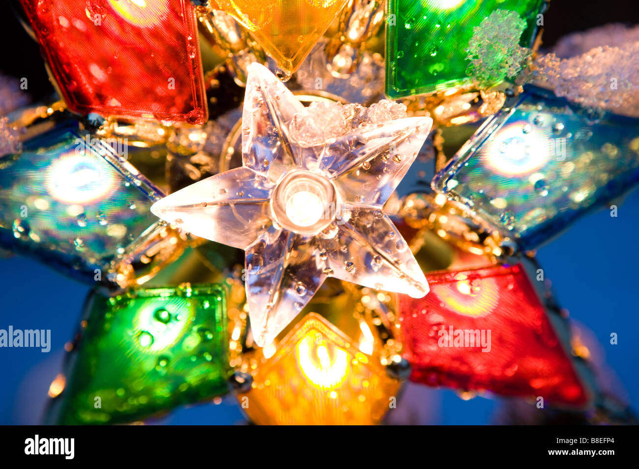 Close Up Of A Lighted Christmas Tree Star Ornament