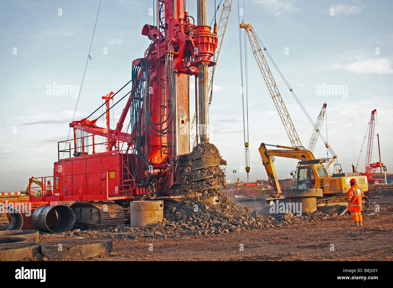 Boring Building Material : Rotary drilling rig spinning excavated material from its
