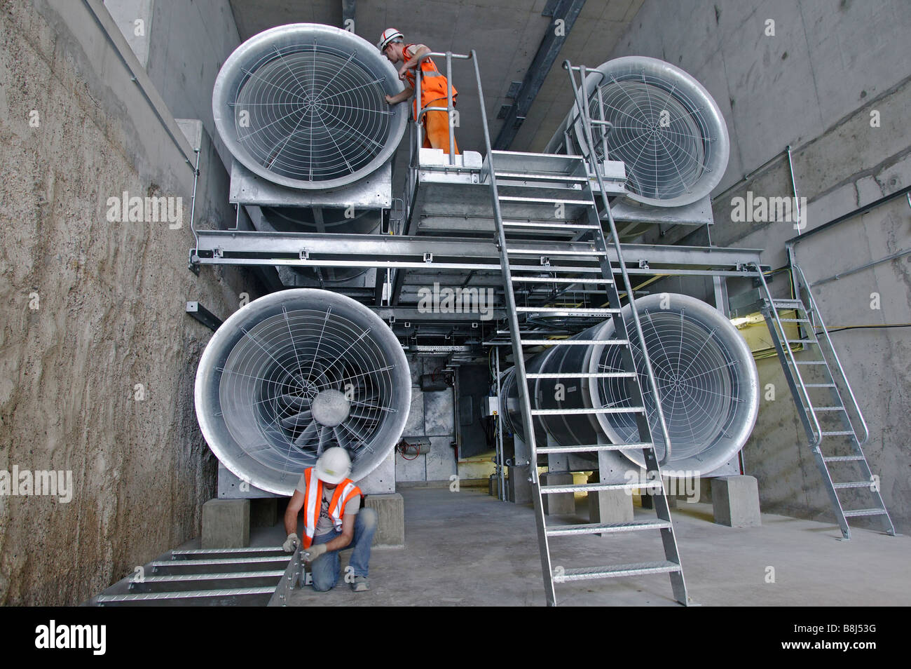 Tunnel Ventilation Fans : Engineers inspecting ventilation fans in high speed