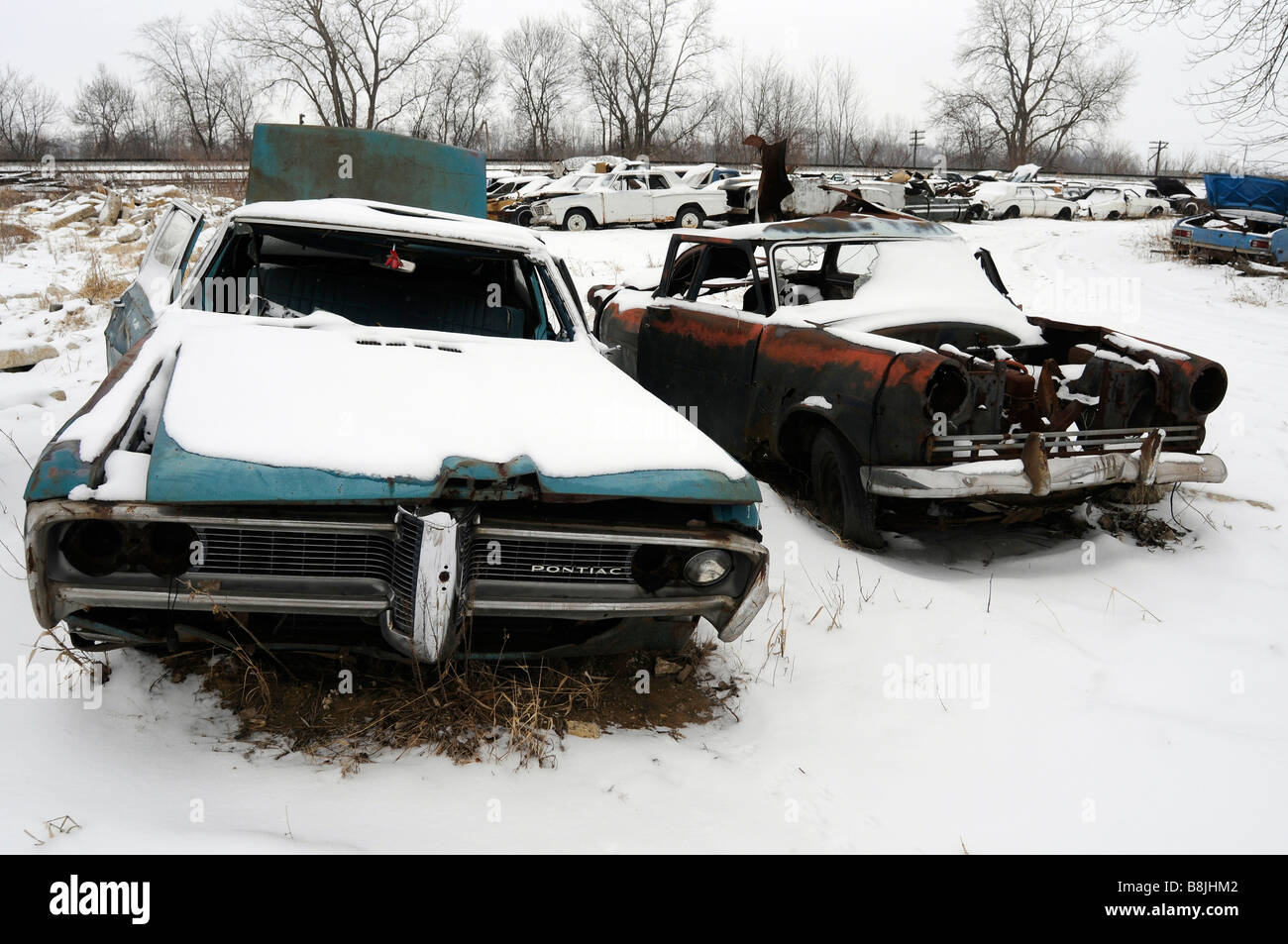 Old cars in a snow covered junk yard Stock Photo, Royalty Free ...