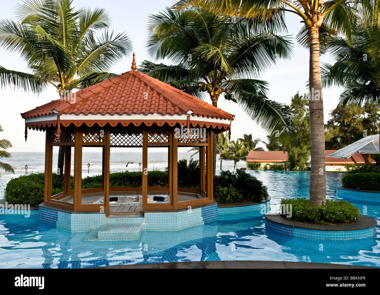 Cool Gazebo In Swimming Pool Surrounded By Islands Of Palm Trees Near A Sandy Beach