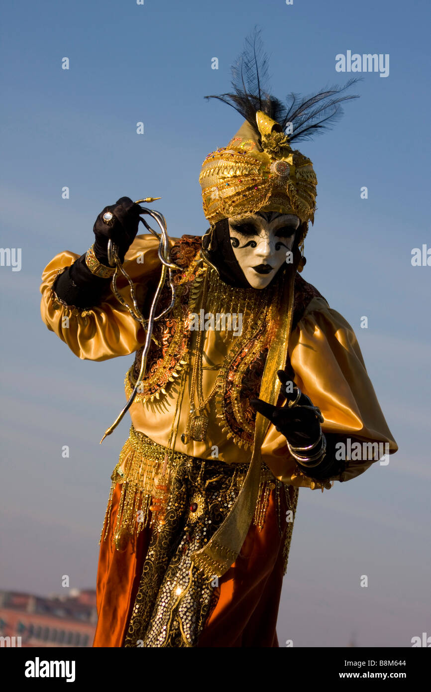 Venice Full Face Black Mirror Mask: Venice Carnival. Full Length Person Gesture Gold Blue Sky