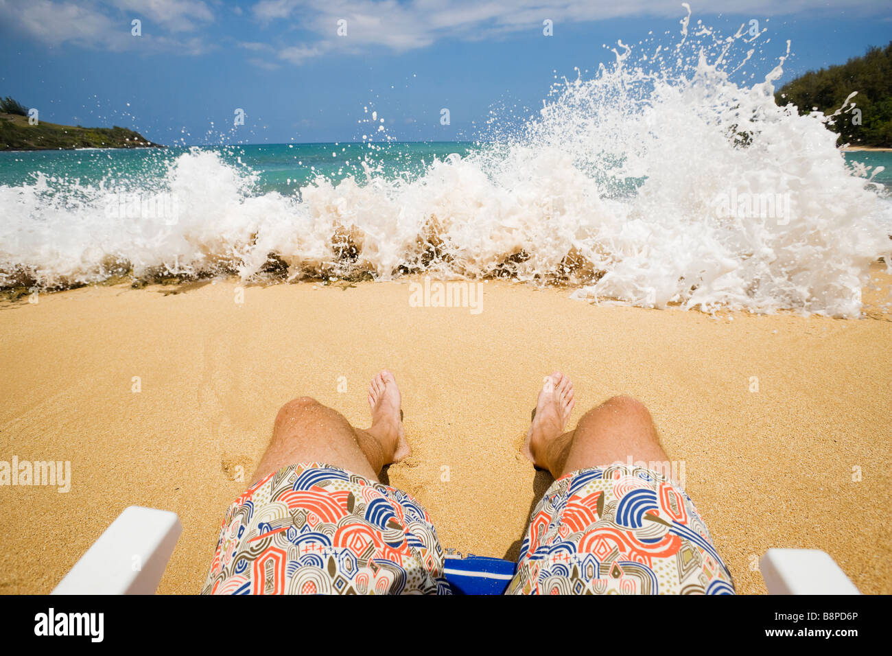 A First Person View Of Sitting In A Chair On The Beach