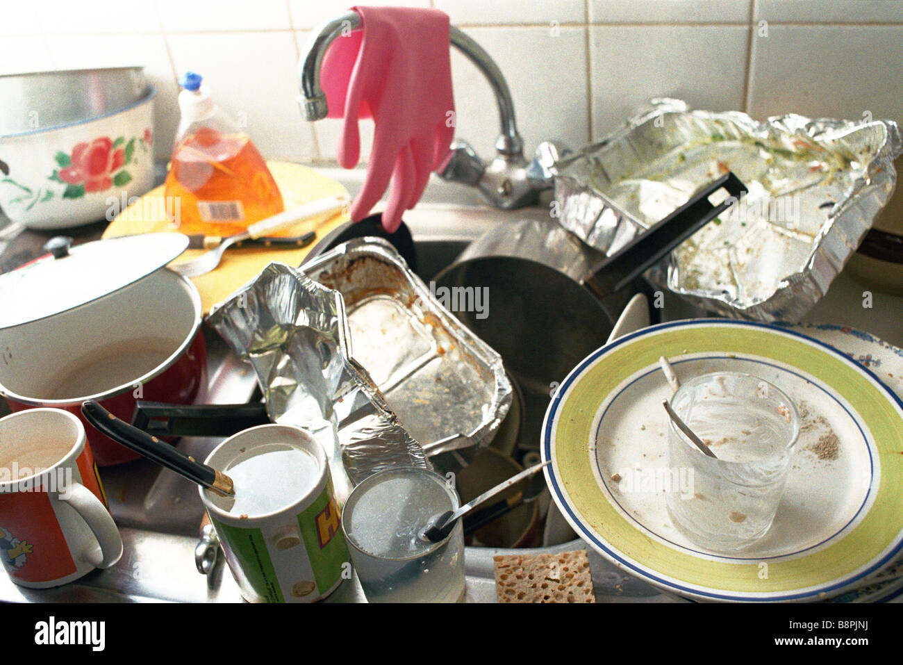 Kitchen Sink With Dishes kitchen sink, counter piled over with dirty dishes stock photo