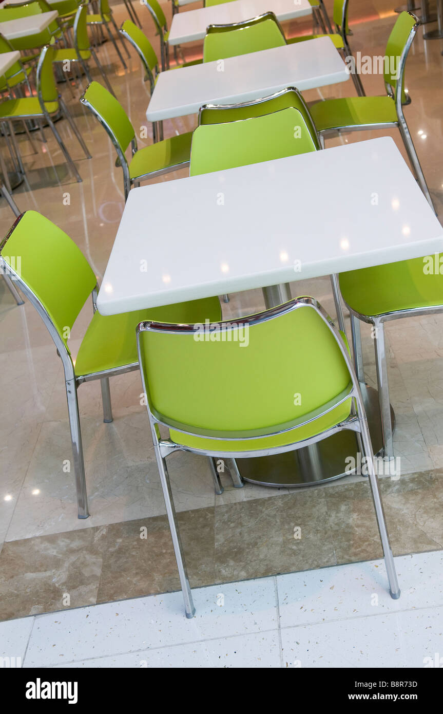 Modern Furniture Uae modern plastic table and chairs in restaurant, dubai, uae stock