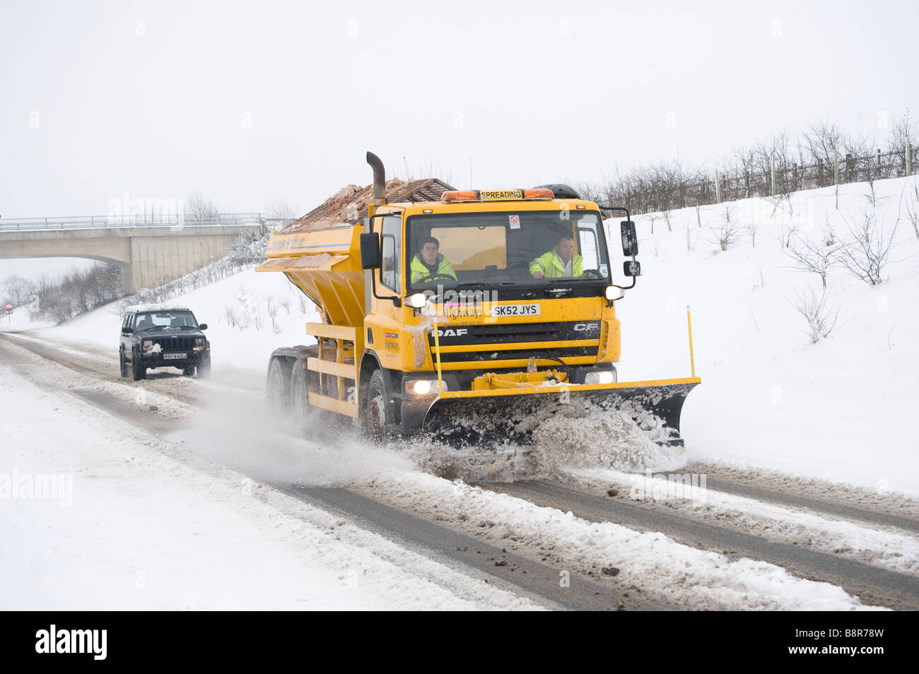 Snow Plough Car >> Gritter lorry with snow plough fitted to the front clearing the roads Stock Photo, Royalty Free ...