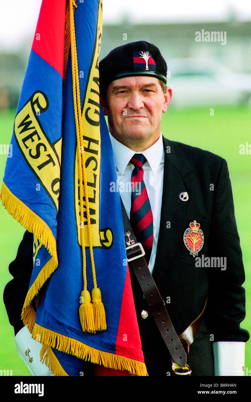 Standard bearer at funeral of welsh guards soldier veteran of the falklands war buried in a