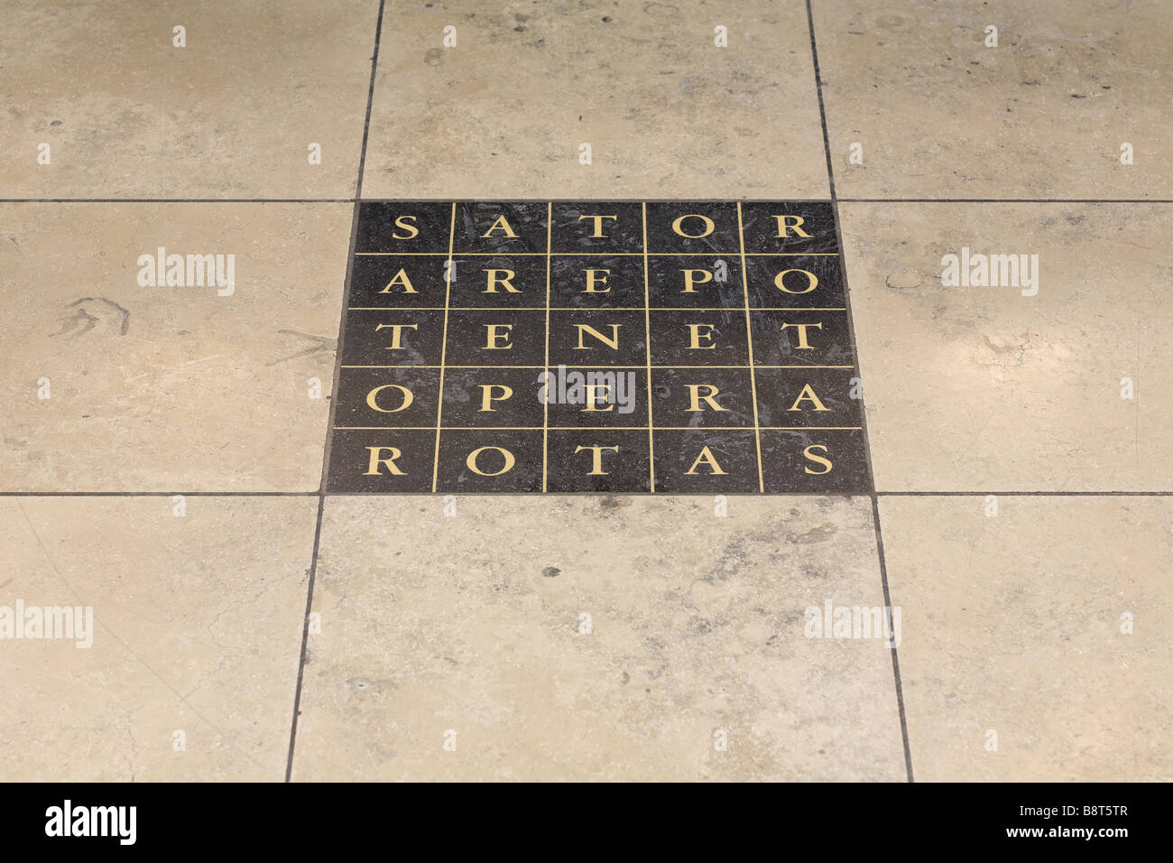 a marble floor tile with a latin palindrome featuring the