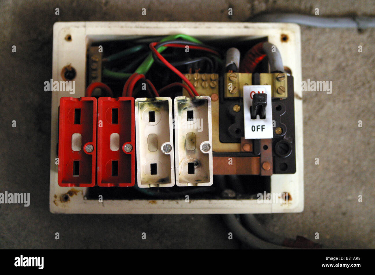 Old style consumer unit electrical wire fuse box stock