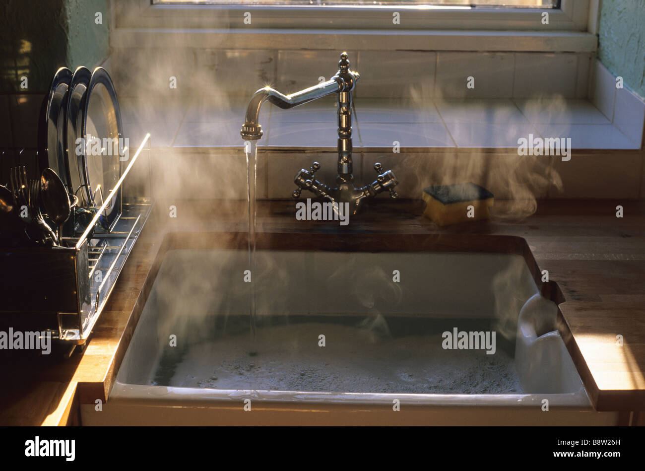 Sunlight Hitting Steam Rising From Hot Washing Up Water In Kitchen ...