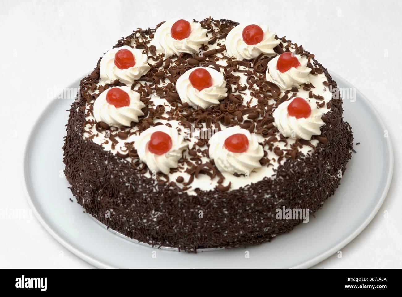 Cherry topped chocolate sponge cake Stock Photo, Royalty Free ...