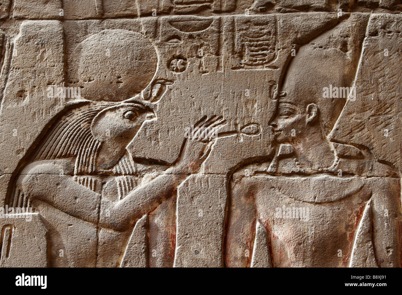 Wall relief showing egyptian god montu holding ankh to the