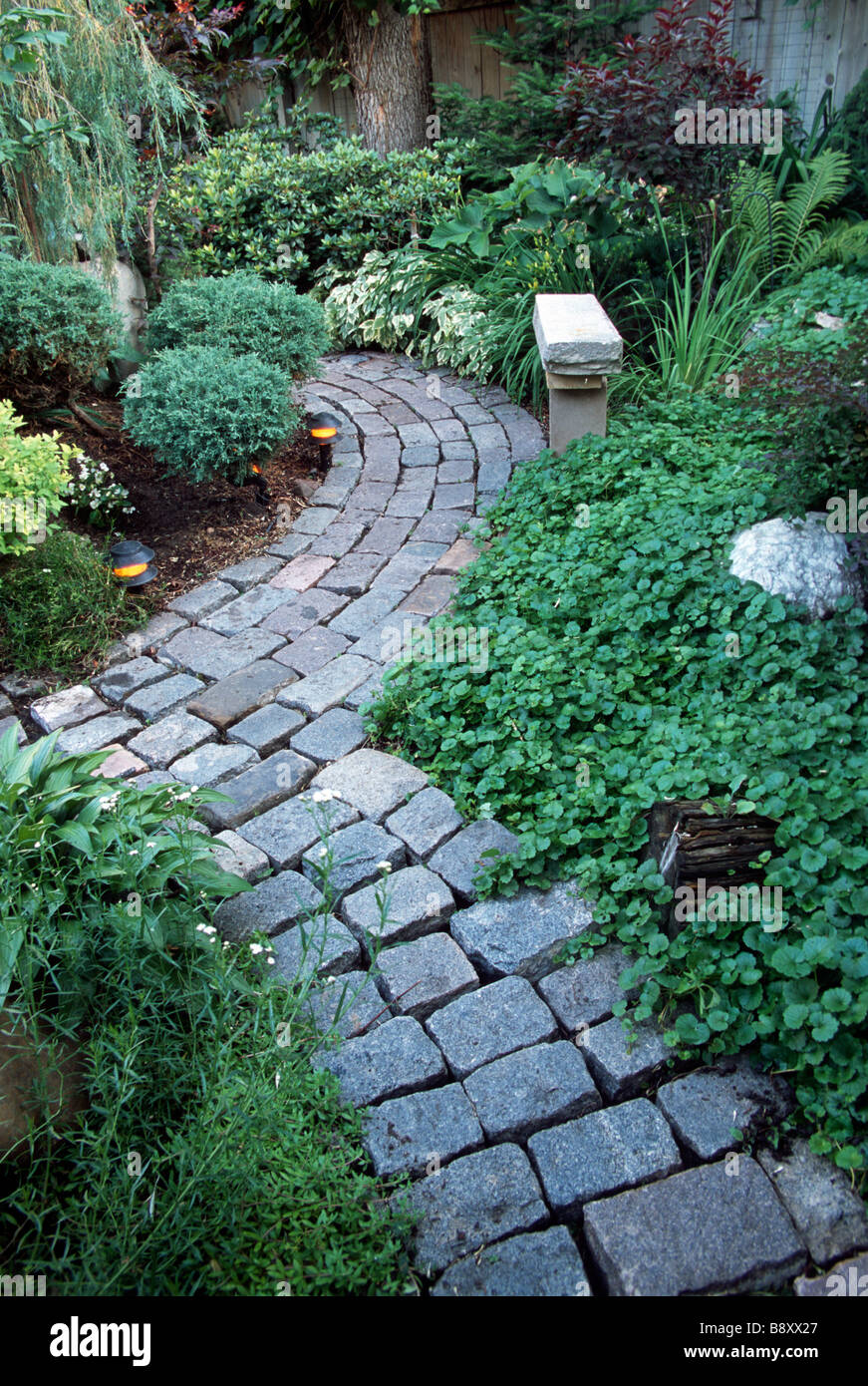 Garden Path Of Recycled City Street Pavers In Minneapolis Garden