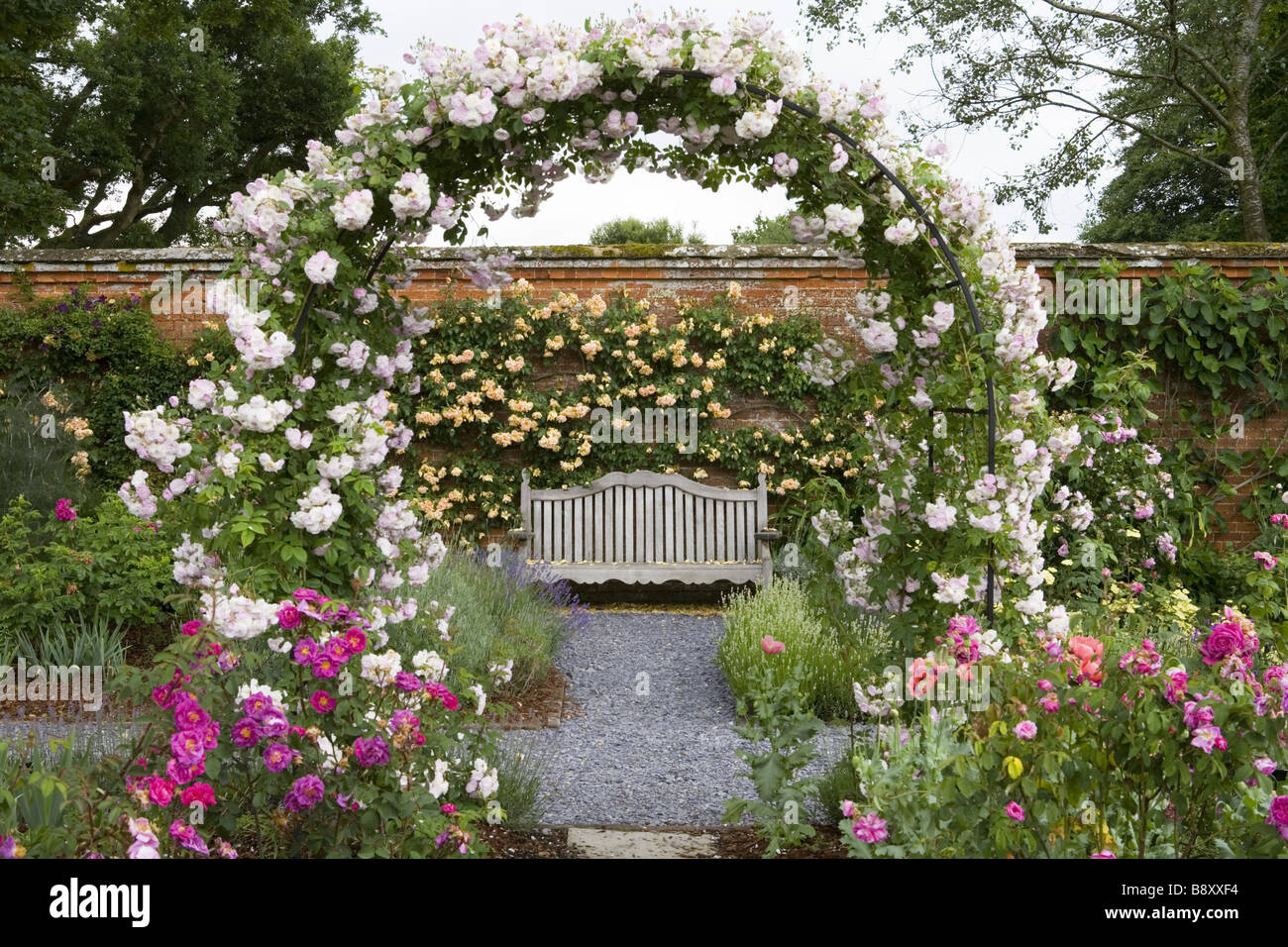 Stock Photo   View Through The Arch And Bench In The Rose Garden At  Mottisfont Abbey Hampshire