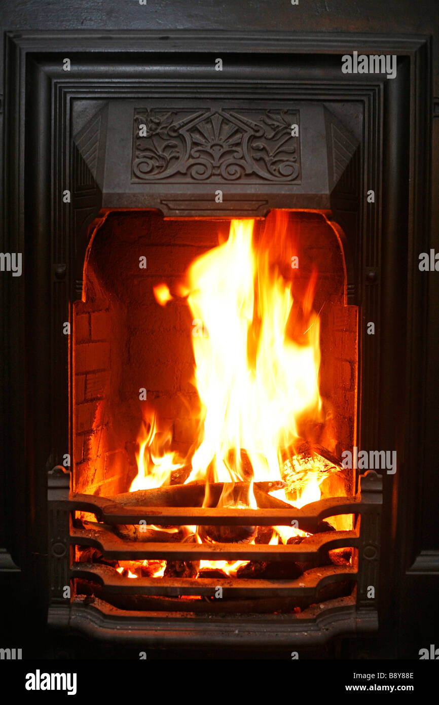flames leap from an open fire burning coal and wood stock photo