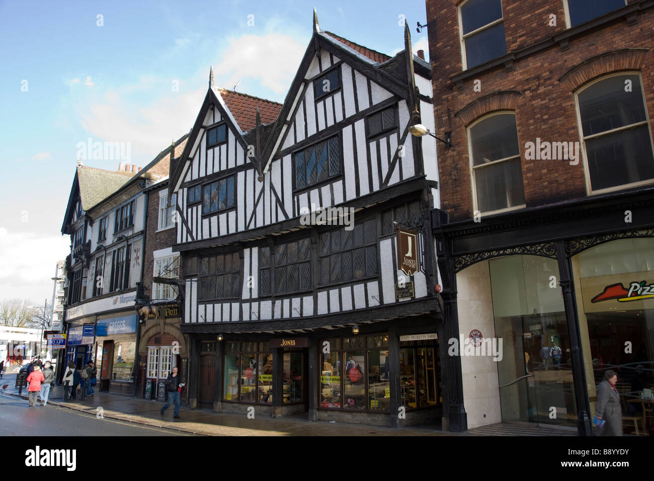 Tudor Facade old wooden tudor style fronted facade on shop front that sells