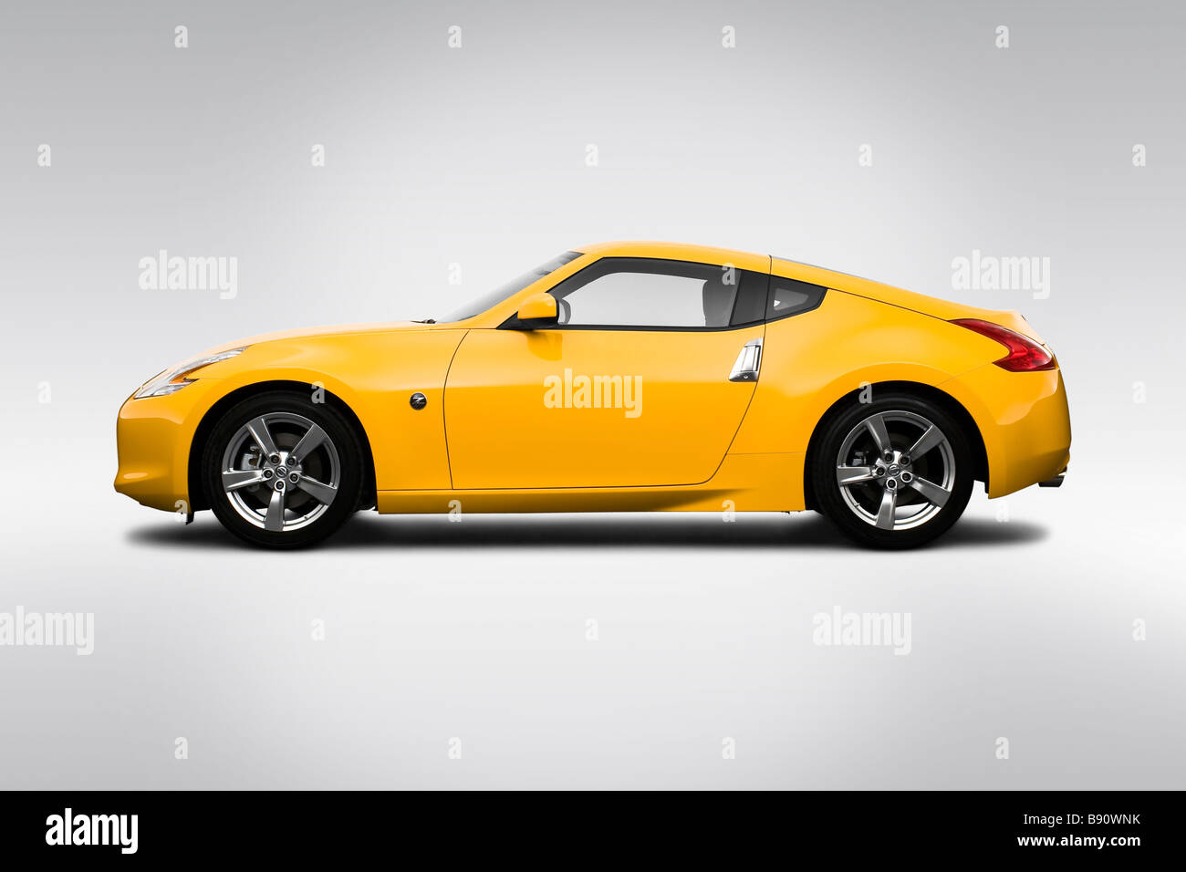 2009 Nissan 370Z In Yellow   Drivers Side Profile   Stock Image