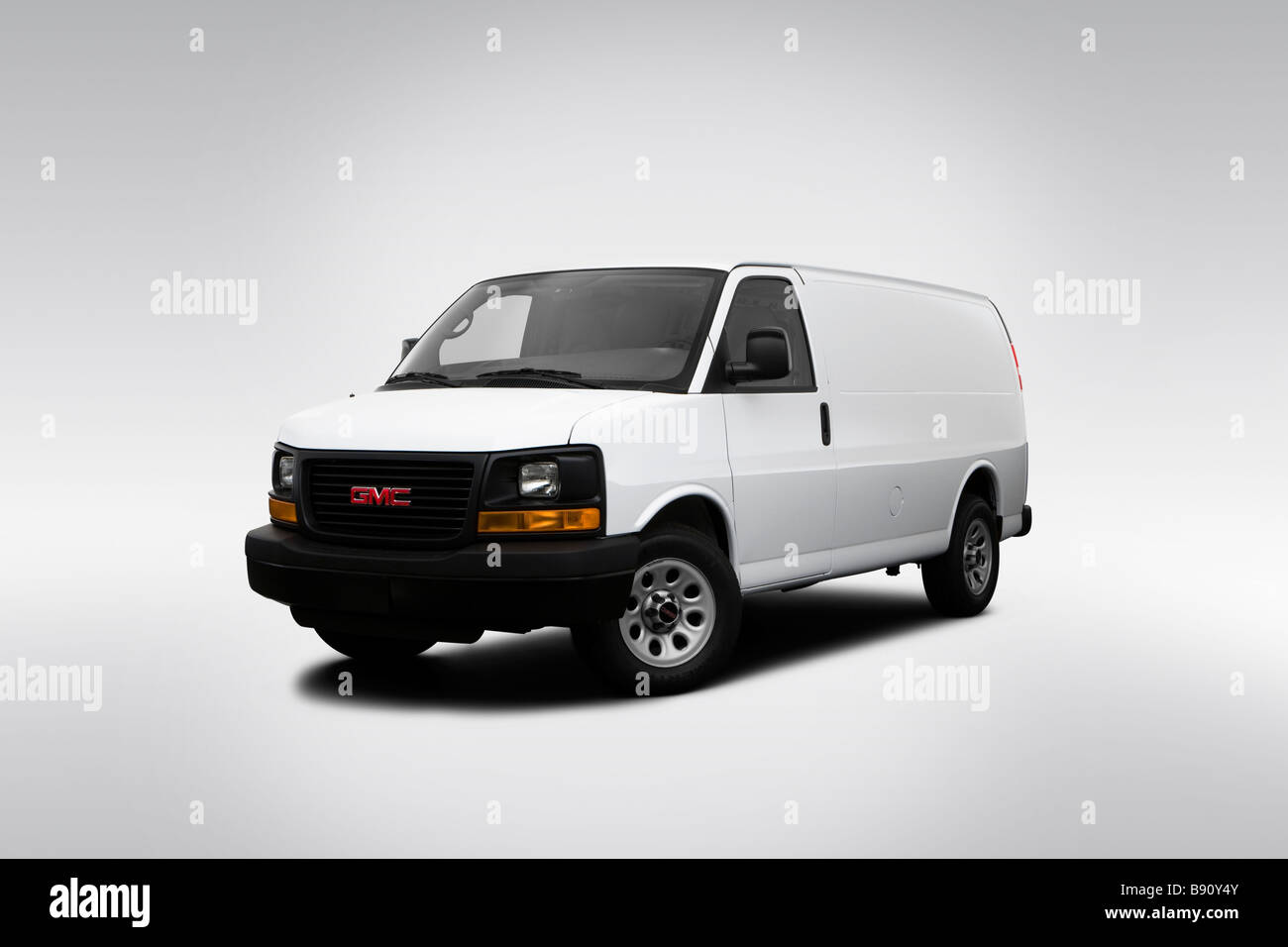 2009 gmc savana cargo 1500 work van in white front angle view