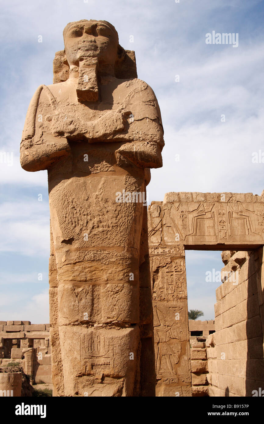 Large stone carved osiris statue karnak temple luxor