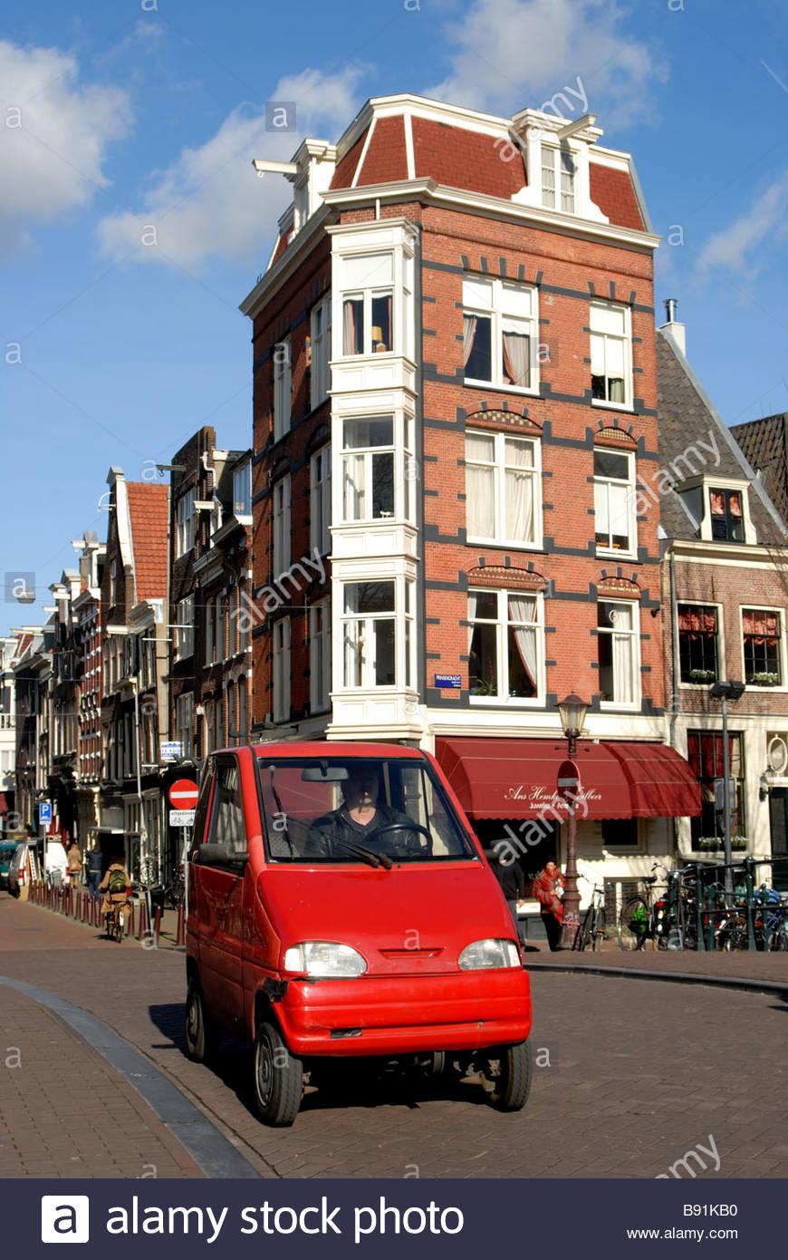 Amsterdam A Red Canta Car Crosses A Bridge On The Prinsengracht