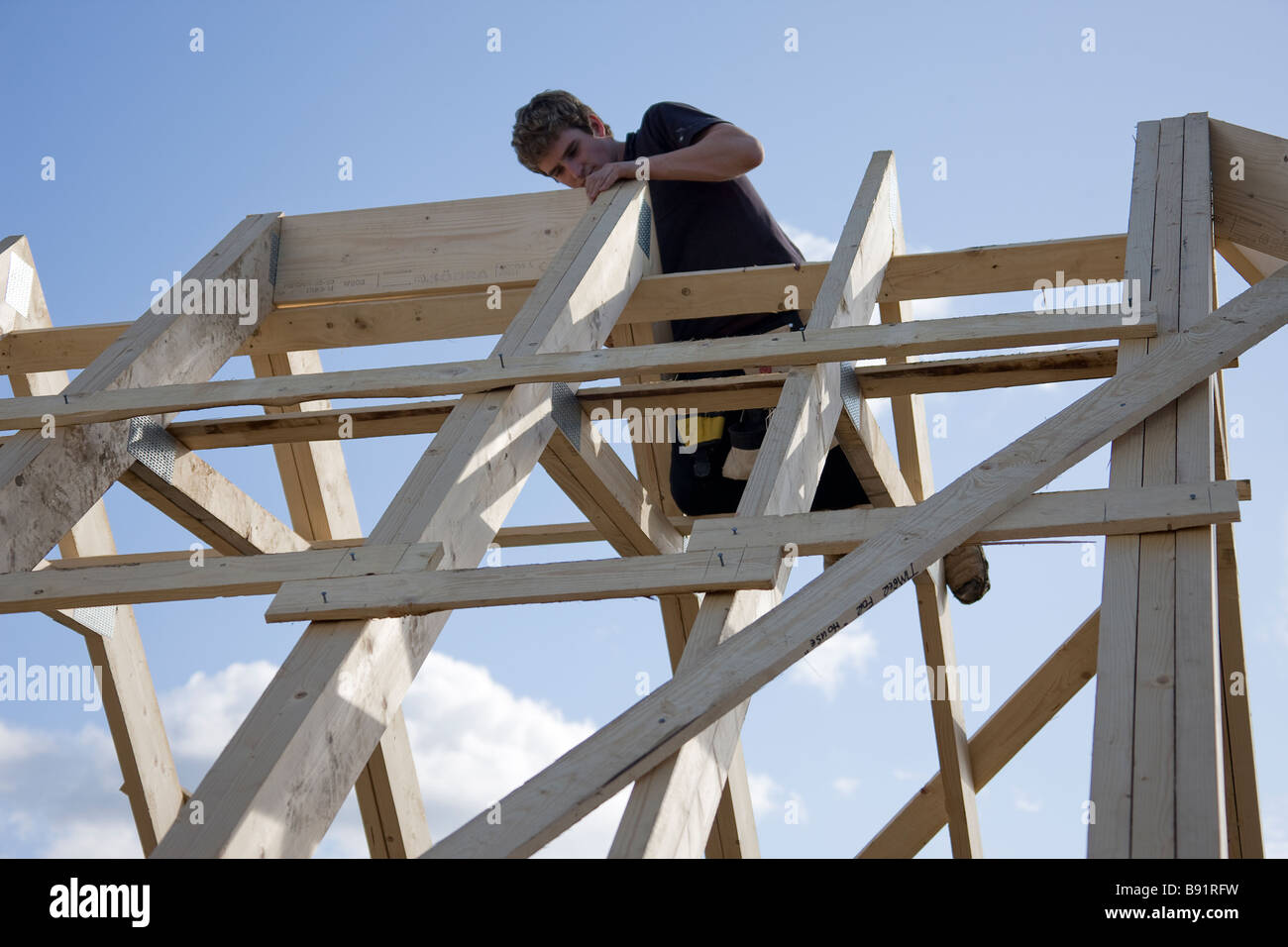 Fixing a ridge board between two attic trusses stock photo for Buy roof trusses online