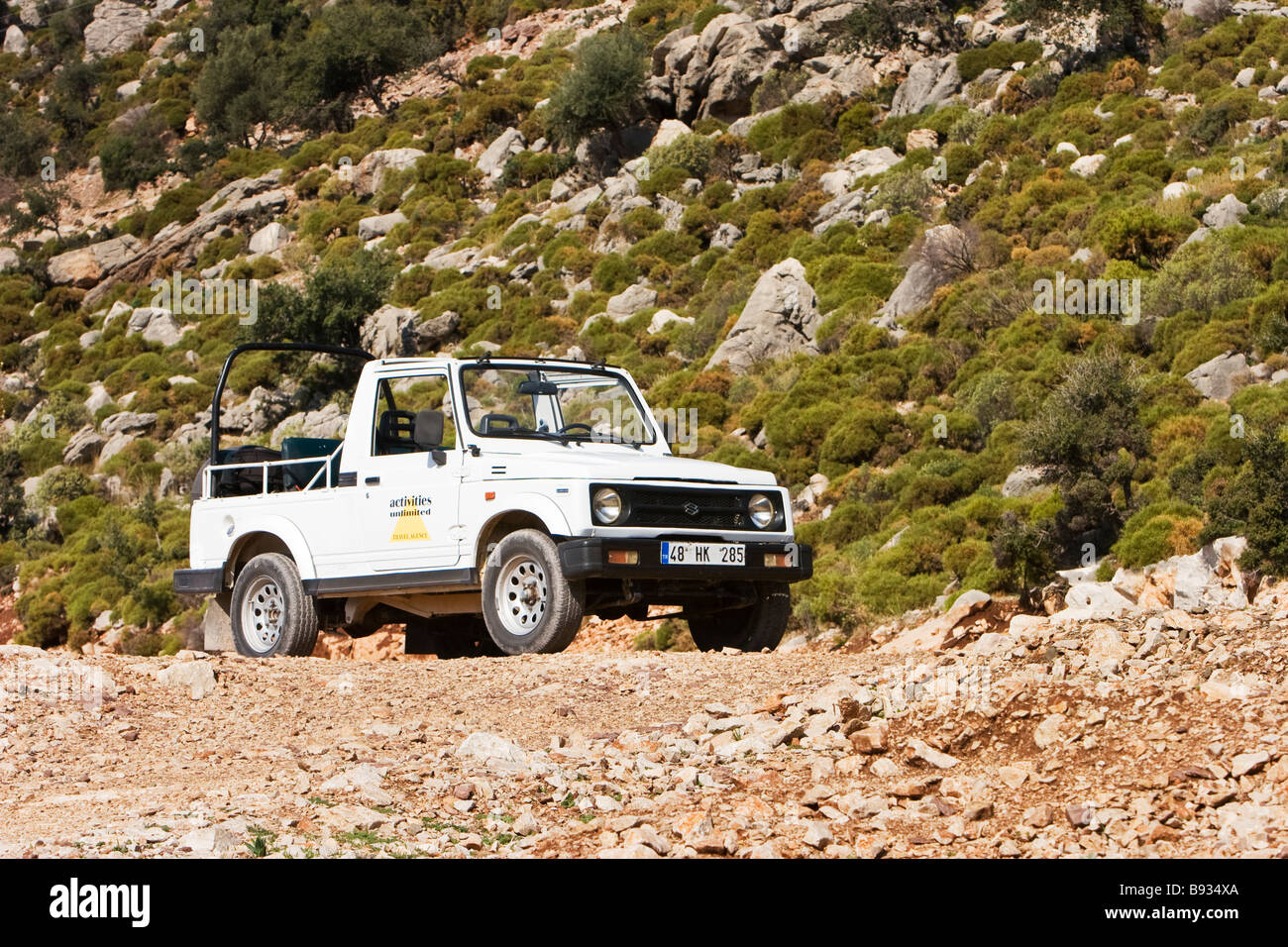 An open top four wheel drive jeep parked off the road in turkey stock image
