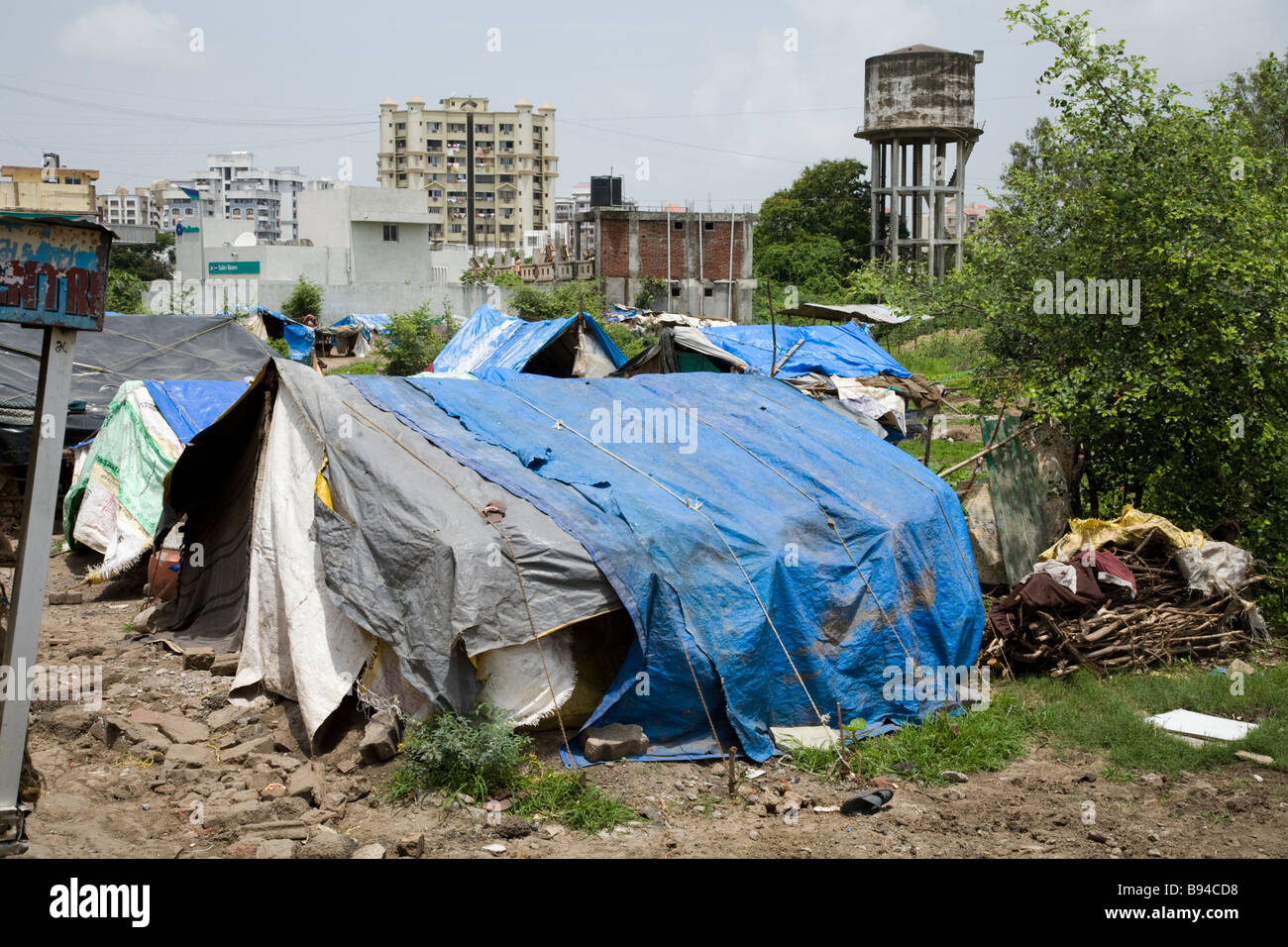 Indian slum houses in a Surat shanty town. Surat Gujarat. India & Indian slum houses in a Surat shanty town. Surat Gujarat. India ...