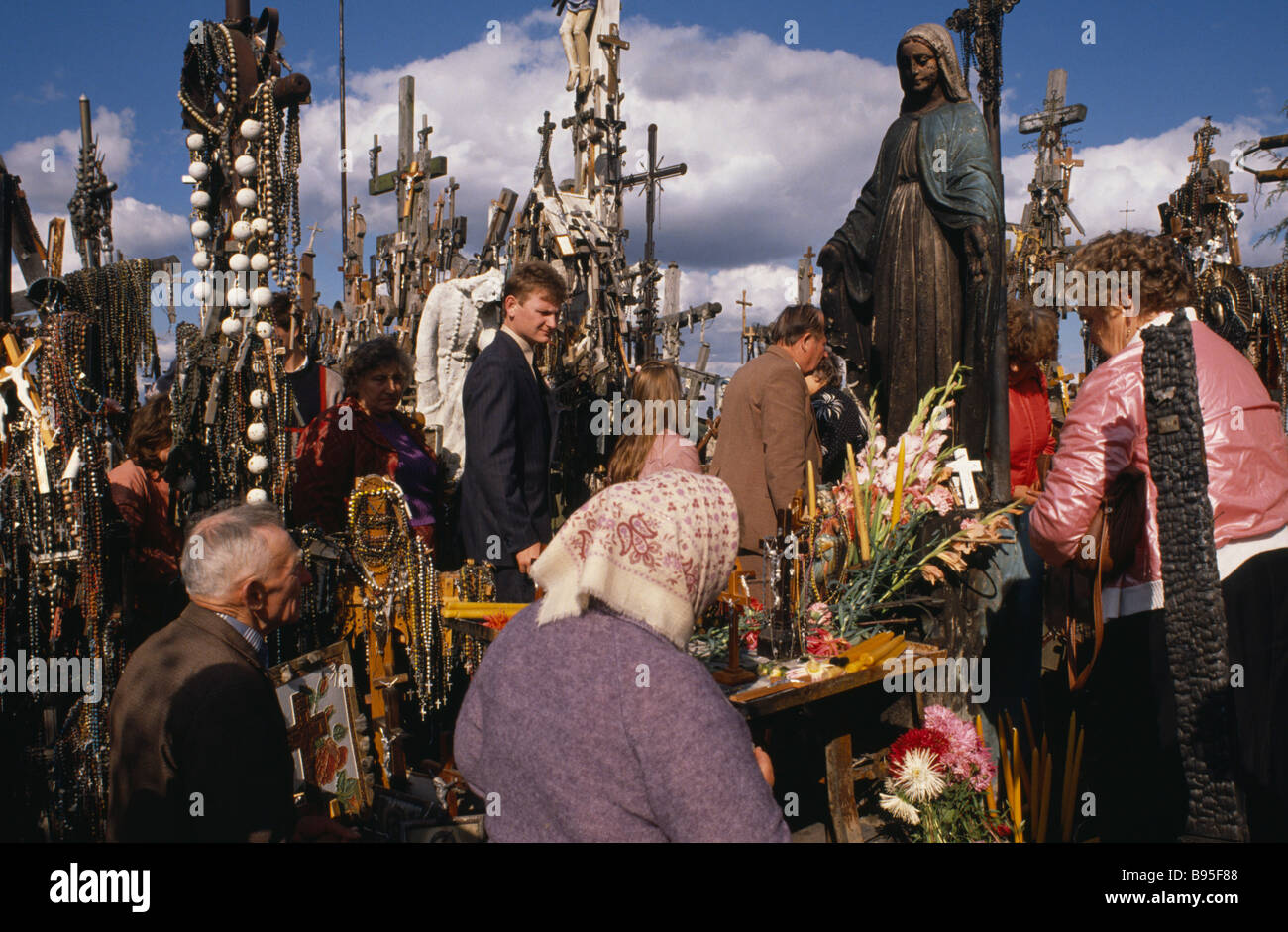 lithuania baltic states hill of crosses people praying amongst