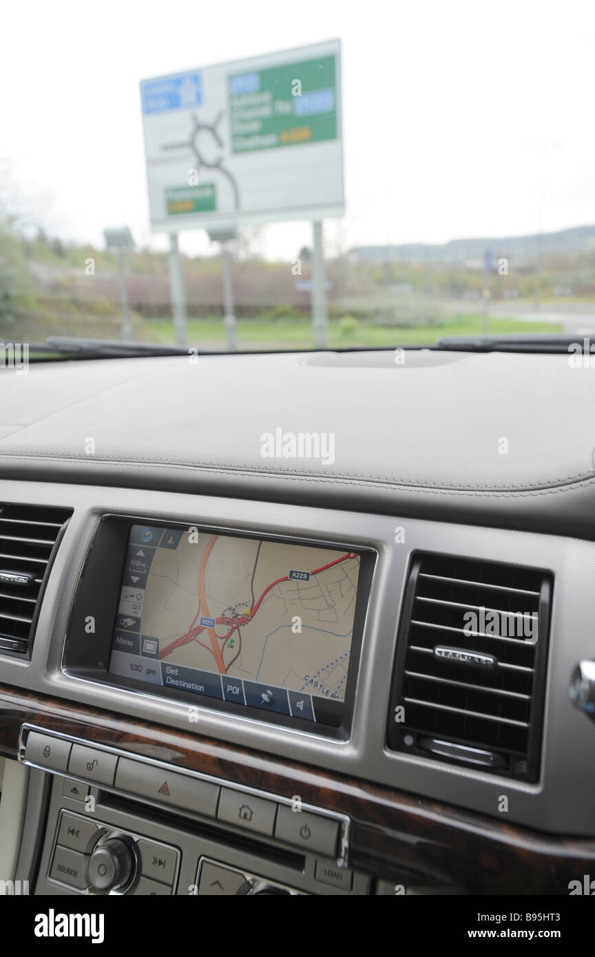 Satellite Navigation In A Car Dashboard Jaguar XF With Road Sign - Car image sign of dashboard