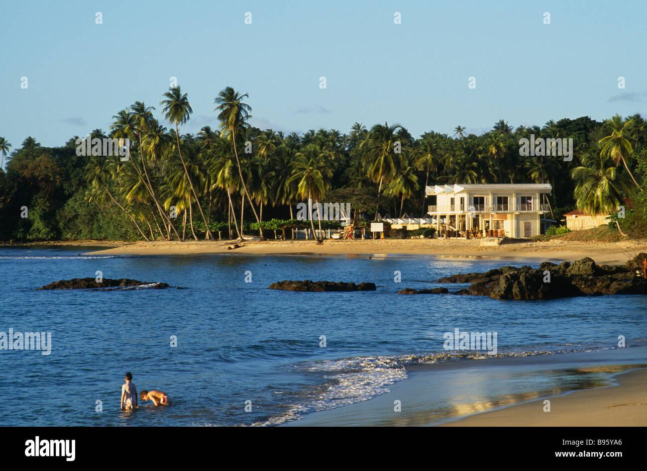 WEST INDIES Caribbean Tobago Grafton Beach People in sea ...