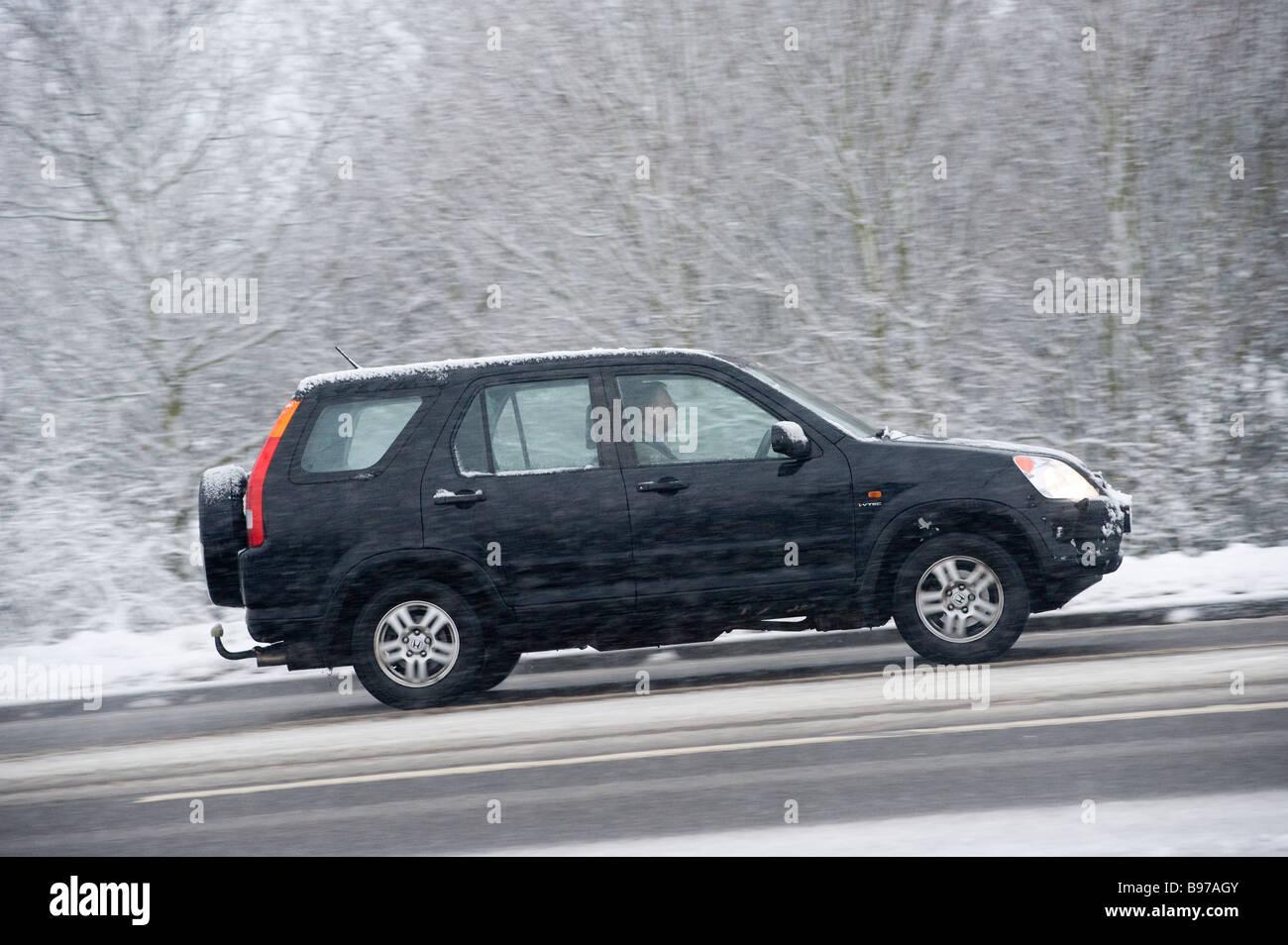 side view of a black honda hrv 4x4 car driving along a. Black Bedroom Furniture Sets. Home Design Ideas