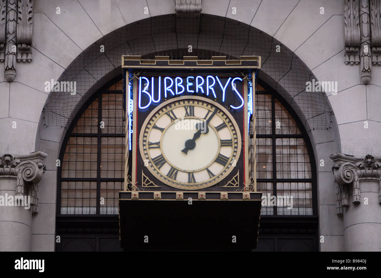 The clock on the wall outside the burberry headquarters in the clock on the wall outside the burberry headquarters in haymarket london amipublicfo Gallery