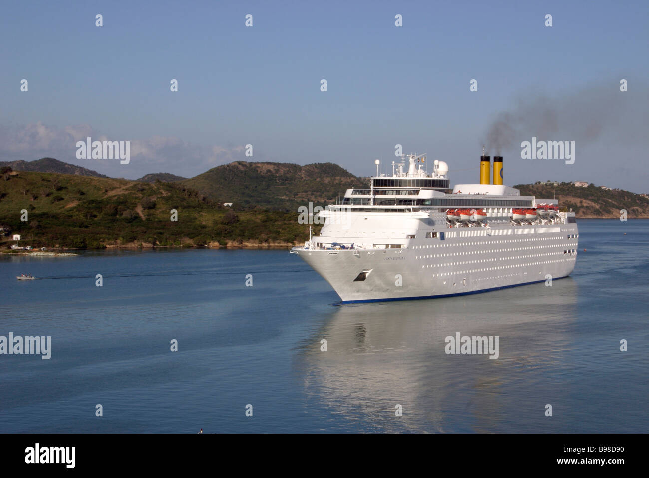 Large White Passenger Cruise Ship Under Sail Funnels Smoke - Is there smoking on cruise ships