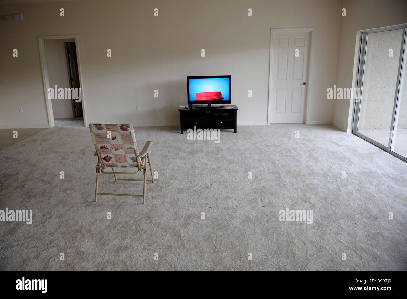 Empty chair in room - Flat Panel Lcd Tv Television Sits Alone In Empty Living Room With Folding Chair