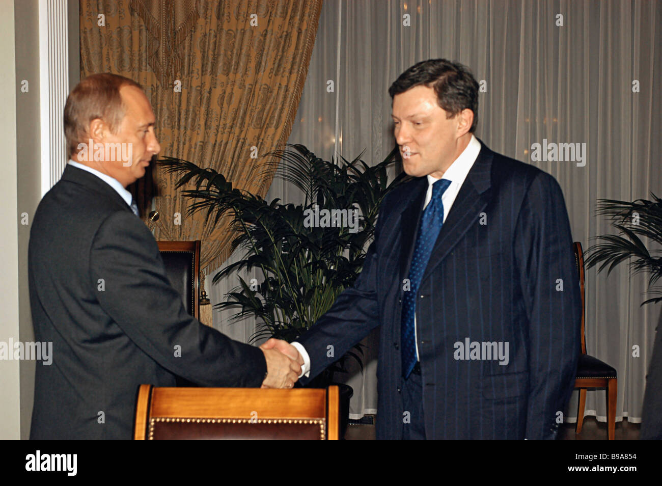 Russian president vladimir putin and grigory yavlinsky yabloko stock russian president vladimir putin and grigory yavlinsky yabloko parliamentary group leader exchanging greetings during a nuclear kristyandbryce Images
