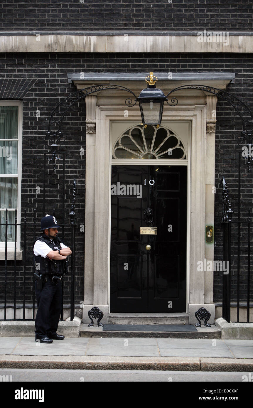 A police officer guarding the front door of number 10 for Front door 10 downing street