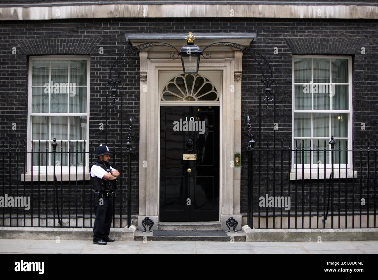 A police officer guarding the front door of number 10 for 10 downing street front door paint