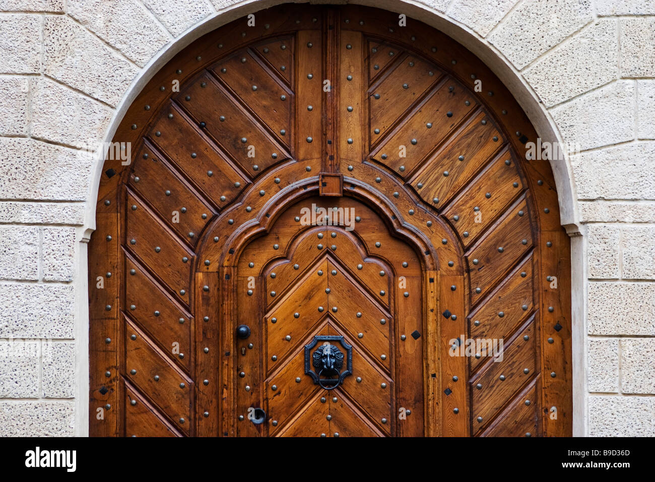 Decorating wicket door images : Big arched medieval house door with wicket gate inside it in ...